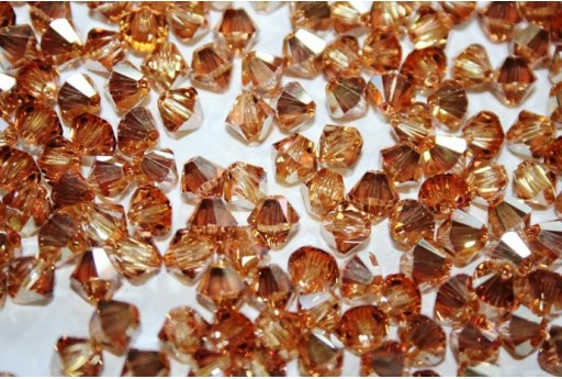 Bicono Swarovski 6mm, 6pz., Crystal Metallic Sunshine 5328