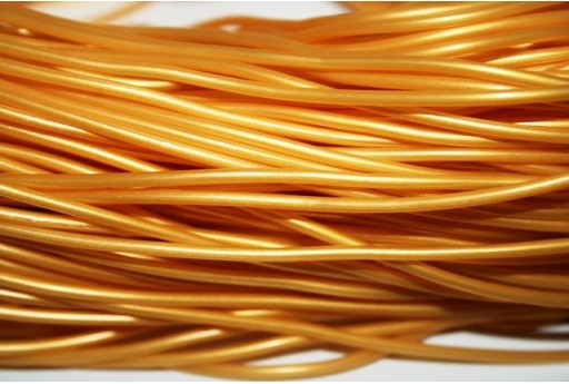 Caucciù Forato Oro 2mm - 4mt.