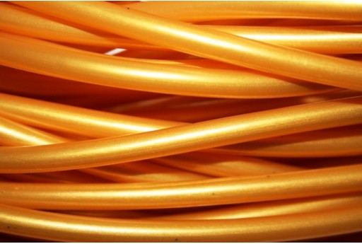 Filo di Caucciù Forato Oro 5mm - 1mt