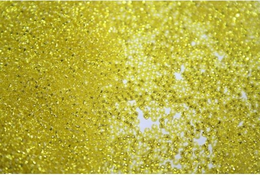 Perline Toho Round Rocailles 15/0, 10gr. Silver-Lined Lemon